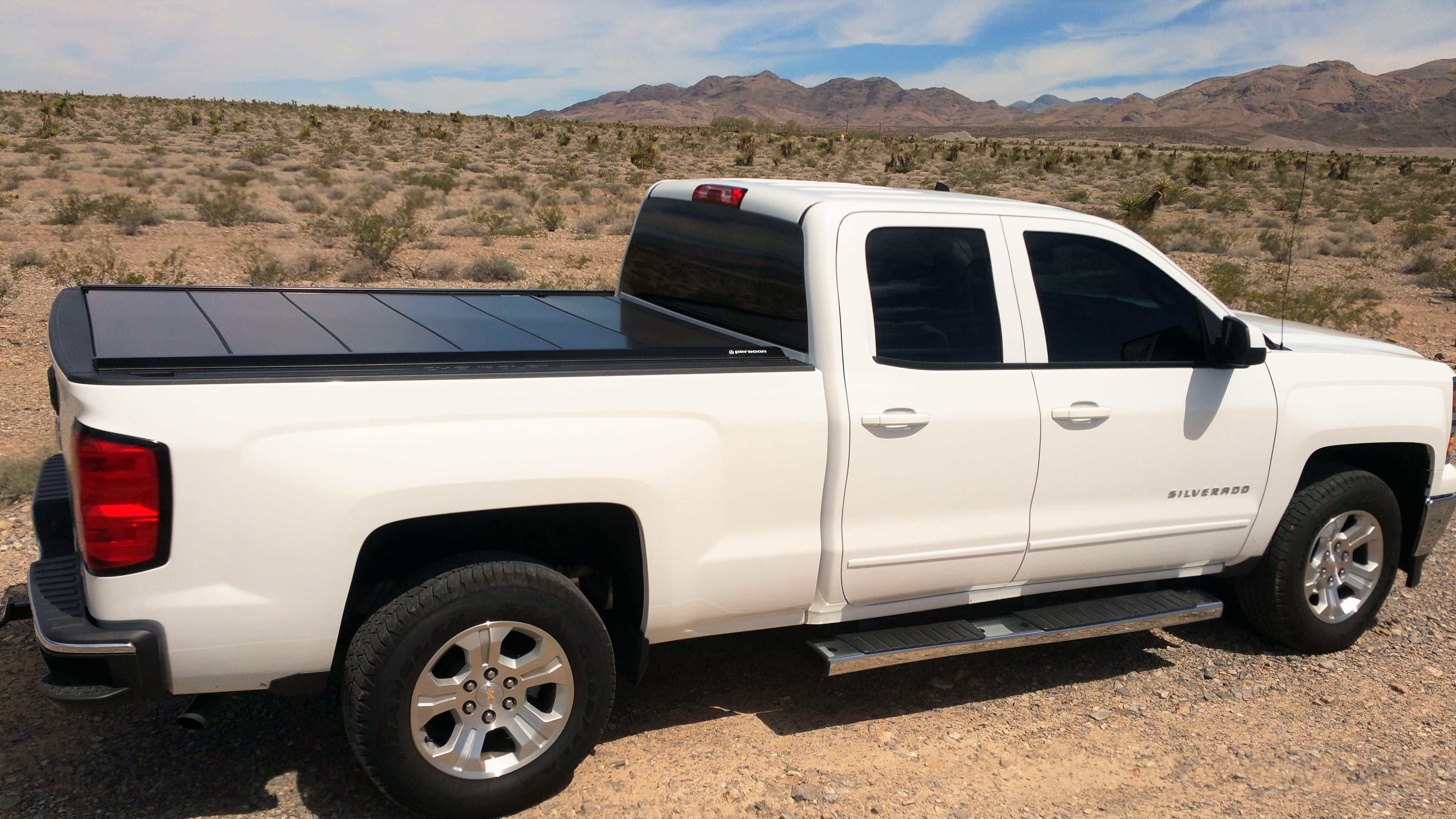 resistant tonneau downloadspermalink truck viewsdownloads great crowd clamp around polycarbonate cover coversgallery retraxone protected pickup bed retractable wheel painted originalviews action uv covers impact with look circle red