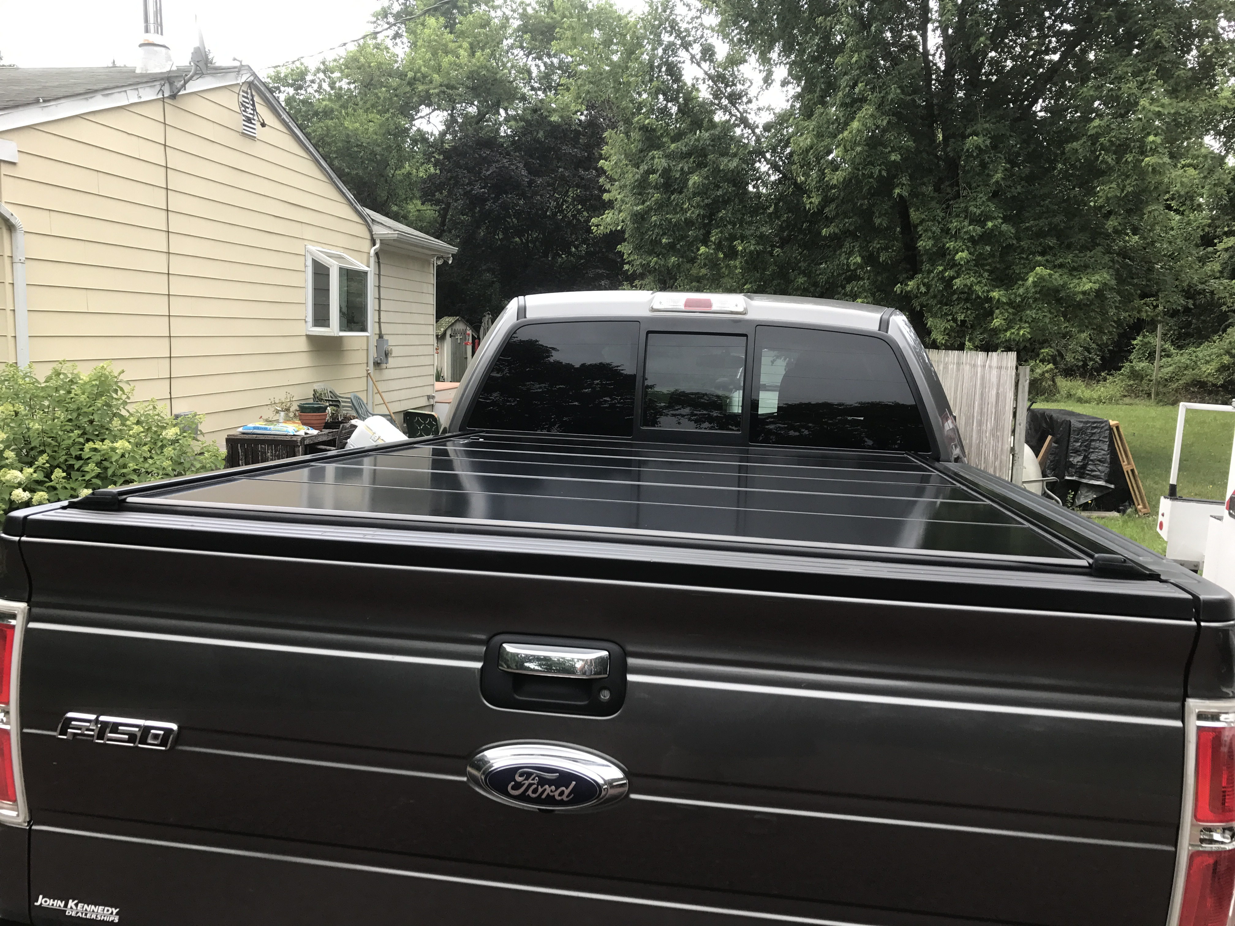 bed tonneau retraxpro ladder img mx sr cover tracrac with truck rack thule retractable